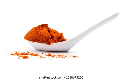 A spoon of Red Paprika powder on white background