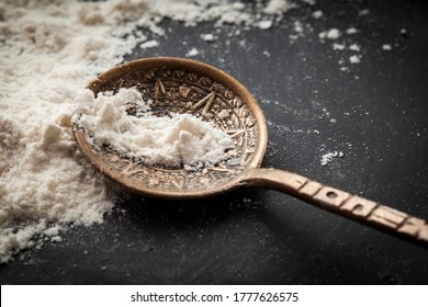 Spoon with some powder on it