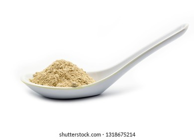 A spoon of white pepper powder on white background, closed up