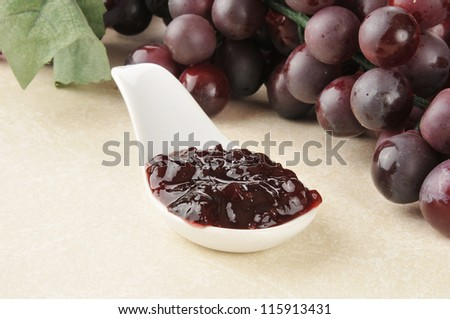 A Spoonful Of Grape Jam With Fresh Grapes