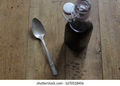 A spoonful of homemade elderberry syrup.