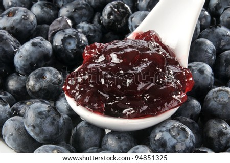 A Spoonful Of Jam On Bed Fresh Blueberries