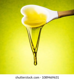 a spoonful of olive oil is poured