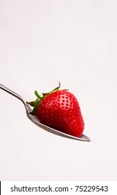 Spoonful of Strawberry Sitting in Spoon White Background Red Food Snack Fruit Silverware
