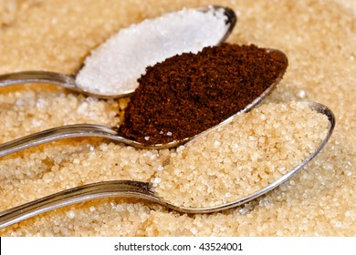 Spoons with different cake ingredients ( sugar , cocoa)