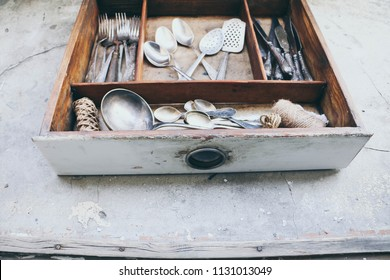 spoons, forks, knives in a wooden box