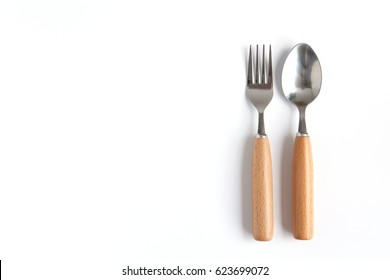 Spoons and forks on white background