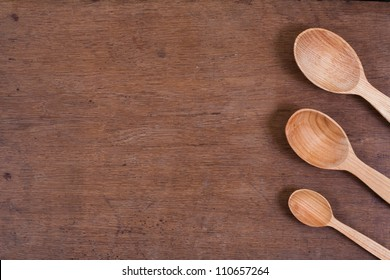Spoons on oak wood table background