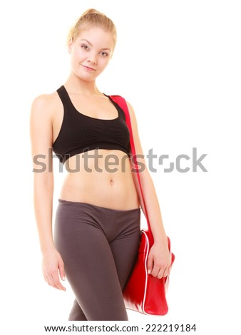 f97b0ec5918163 Fitness sporty girl in sportswear with red gym bag isolated on white. -  Image