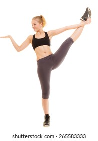 Sport and active lifestyle. Full length of fitness sporty girl stretching showing open hand palm with blank copy space for product or text isolated.