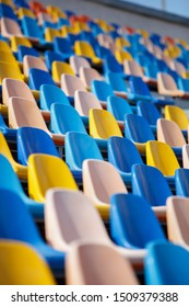 Sport arena bleachers outdoor.Plastic seat for fans on sports competition.Big stadium venue seats for spectators.Vertical background, no people