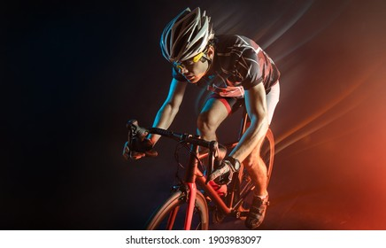 Sport. Athlete cyclists in silhouettes on dark background
