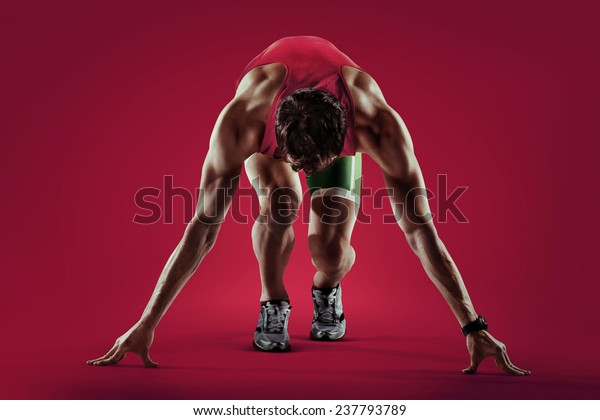 Sport. Athlete runner in silhouettes on red background