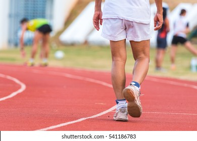 Sport background, close up of runner's legs run on the street