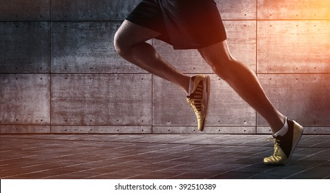 Sport background, close up of urban runner's legs run on the street with copy space