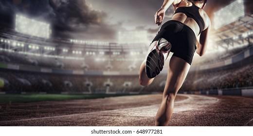 Sport background. Runner on the stadium. Dramatic scene.