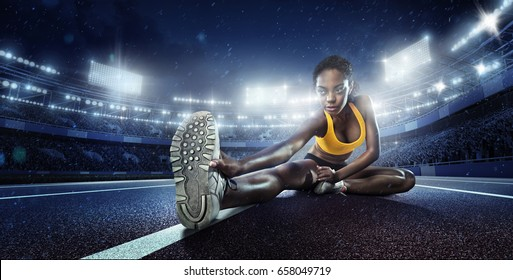 Sport backgrounds. Runner. Stretching before the stadium.