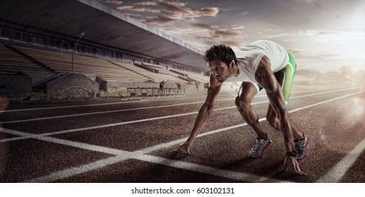 Sport backgrounds. Sprinter starting on the running track. Dramatic image.
