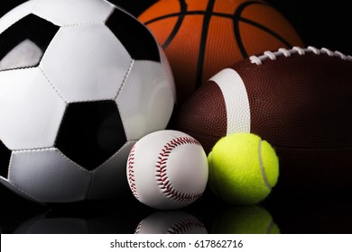 sport balls isolated on black background