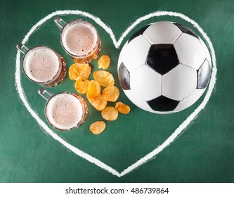Sport bar set from beer mugs, chips and soccer ball in drawing heart on green background.
