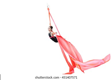 Sport. Beautiful dancer on aerial silk in studio on white background. Air acrobatic young women stunts isolated