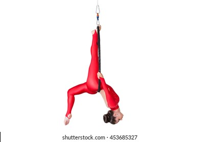 Sport. Beautiful dancer on aerial silk in studio on white background. Air acrobatic young women takes the twine isolated