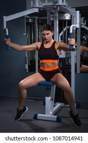Sport. Beautiful woman in gym. Halthy concept