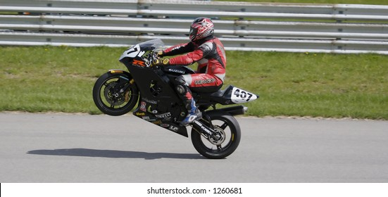 Sport Bike Pulling a Wheelie after powering out of turn