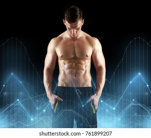 sport, bodybuilding, fitness and people concept - young man or bodybuilder with bare torso over black background and diagram charts