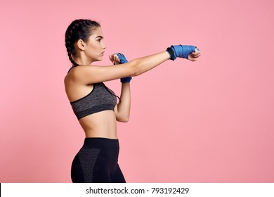 sport, boxing, woman on a pink background