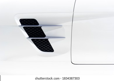 Sport car bodywork, detail of white racing vehicle with air intake, automobile industry