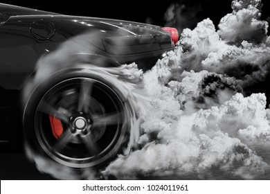 Sport car burns tires with smoking on track in preparation for the race.