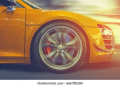 Sport car running at high speed on road ,sun set ,Vintage sports car