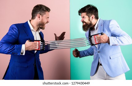 Sport competition. Business as sport concept. Business rivalry or battle. Business people fight for leadership. Men stretching expander opposite sides. Business competition between entrepreneurs.