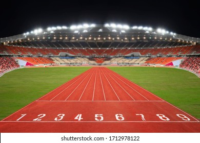 Sport competition race running red track in stadium.