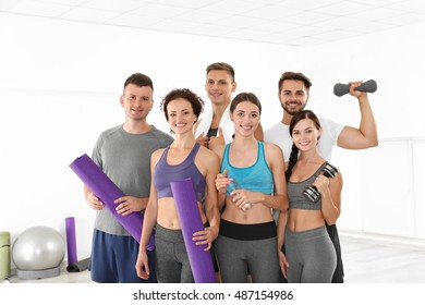 Sport concept. Group of people in gym