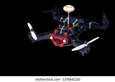 Sport copter. Dron, quad copter Isolated on black background. Remote controlled dron, quadro copter with digital camera. Closeup. New tool for aerial photo and video.