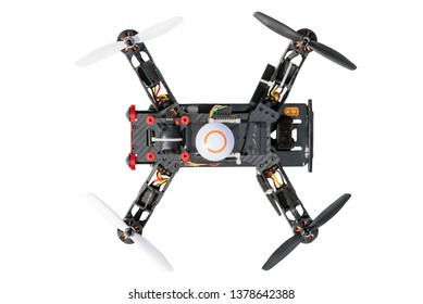 Sport copter. Dron, quad copter Isolated on white background. Remote controlled dron, quadro copter with digital camera. Closeup. New tool for aerial photo and video.