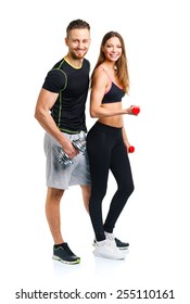 Sport couple - man and woman with dumbbells on the white background