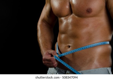 Sport and diet. Attractive man with muscular body.