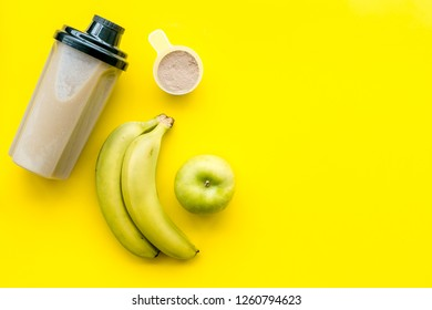 sport diet with protein nutrition on yellow background top view mock up