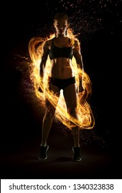 Sport. Dramatic portrait of professional bodybuilder. Winner in a competition. Fire and energy.