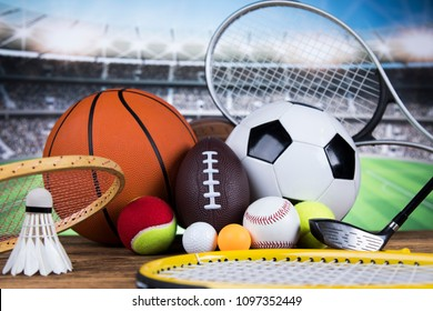Sport equipment and balls, stadium background