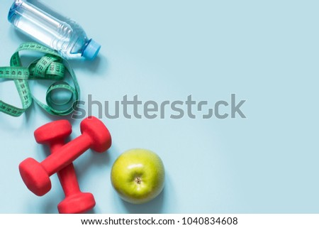 Sport equipment. Creative flat lay of sport and fitness equipments on blue background with copy space.