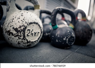 Sport equipment in gym. Kettlebell on floor background