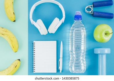 Sport equipment on color background top view