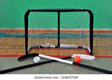 Sport equipment for playing in florbol. Balls with sticks and gates for floorball