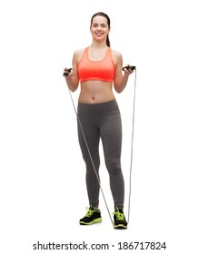 sport, excercise and healthcare - sporty woman with skipping rope