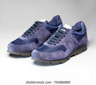 Sport fashion shoes on a gray background
