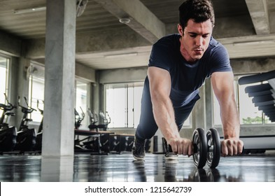 sport, fitness, bodybuilding, lifestyle and people concept - man exercising work out and flexing muscles in gym